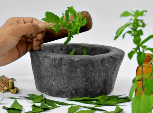 grinding tulsi for paste, health benefits and beauty benefits