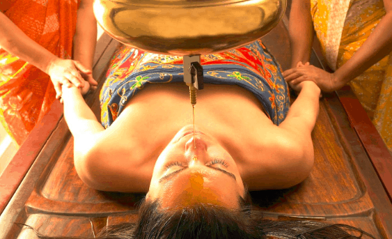 shirodhara ayurvedic massage therapy female