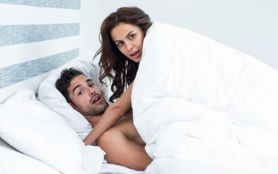 shocked couple in bed having sex